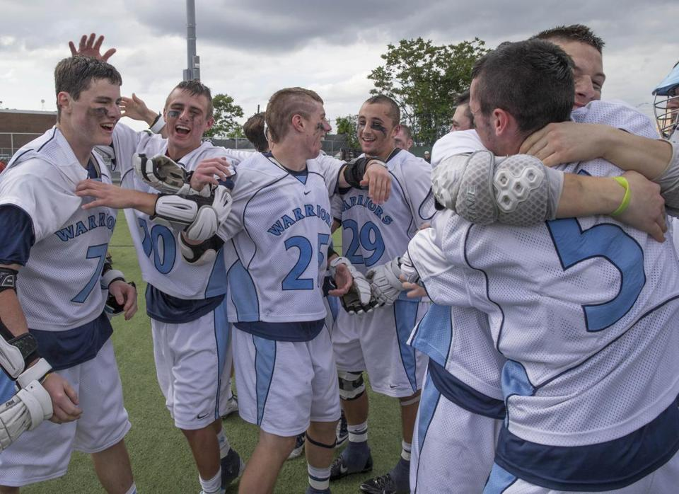 The Medfield High School boys' lacrosse team celebrates winning the Division 2 state title Saturday over Hingham, 13-6.