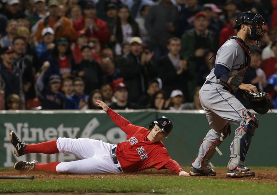 Brock Holt slides across the plate while scoring on a Dustin Pedroia double in the seventh inning. (Barry Chin/Globe Staff)