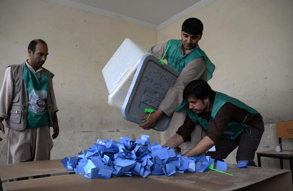 Afghan election workers emptied a ballot box during the counting process at a polling station in Mazar-i-Sharif on Saturday.