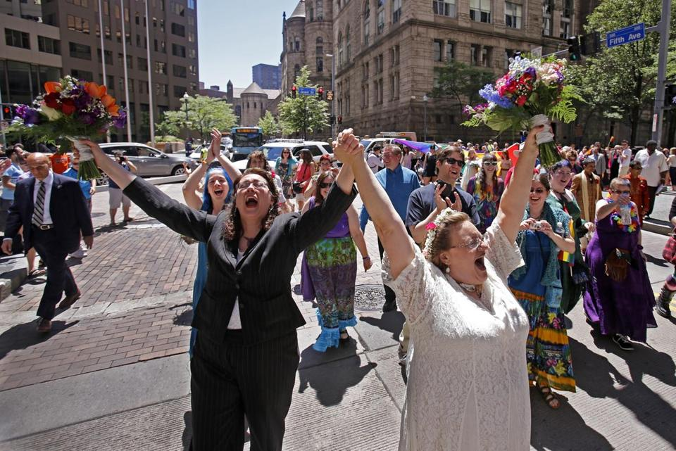 Nancy Janda (left) and her new spouse, Larisa Van Winkle, marched in downtown Pittsburgh after being among the 19 gay couples married by the mayor on Sunday. Gay marriage opponents have faced a string of defeats in recent months.