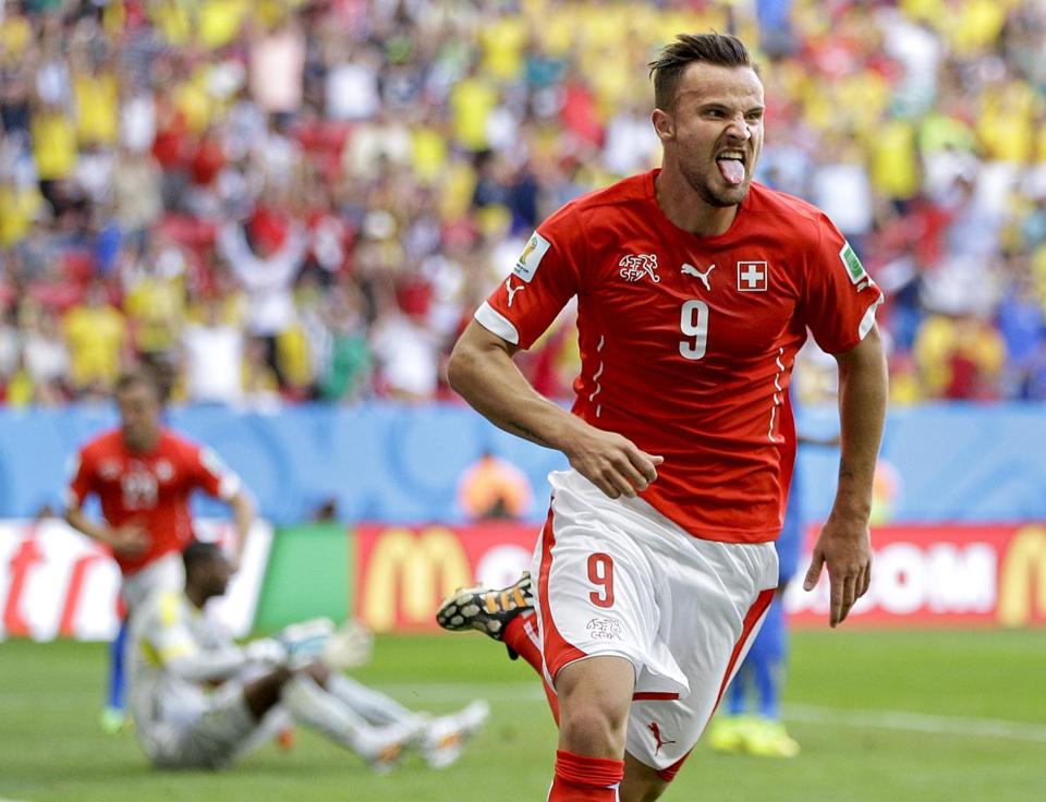Switzerland's Haris Seferovic, a second-half substitute, celebrates his go-ahead goal in stoppage time.  (AP Photo/Michael Sohn)