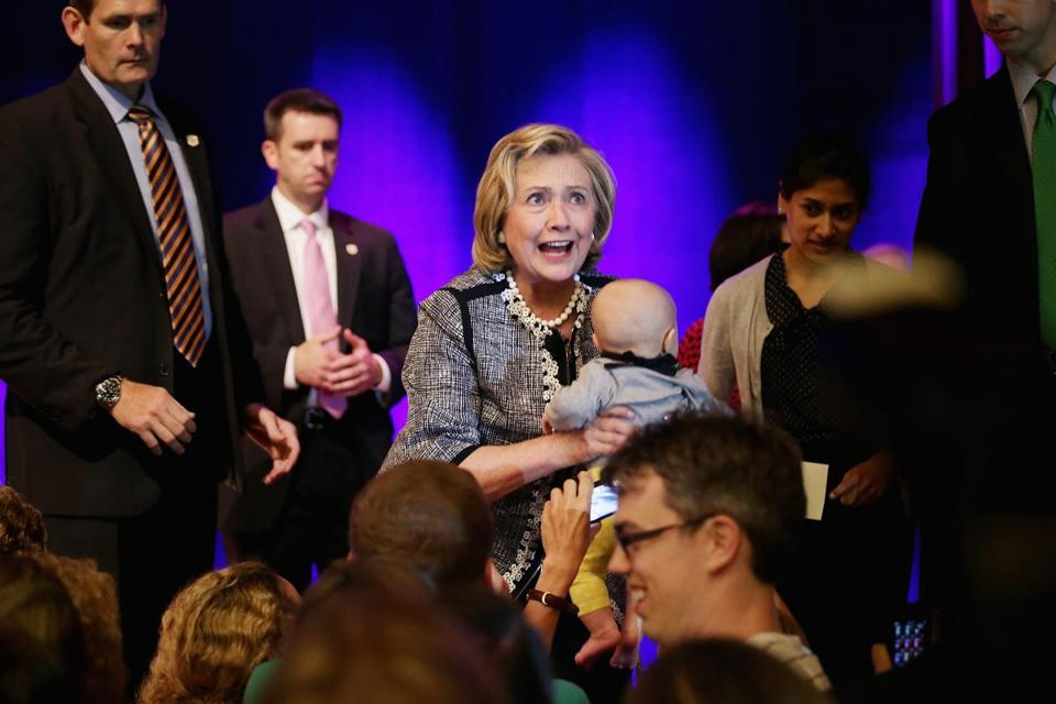 Former Secretary of State Hillary Rodham Clinton looked surprised as she was handed a baby during a stop on her book tour at George Washington University.