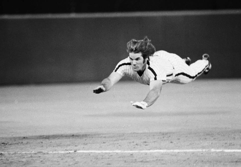 FILE - In this June 3, 1981 file photo, Philadelphia Phillies' Pete Rose dives headfirst for third base during a baseball game against the New York Mets in Philadelphia. Even Rose, the man who made the headfirst slide fashionable, says there's a time and place to be prudent. As in, no need to get your nose bashed in at home plate. (AP Photo/Rusty Kennedy, File)