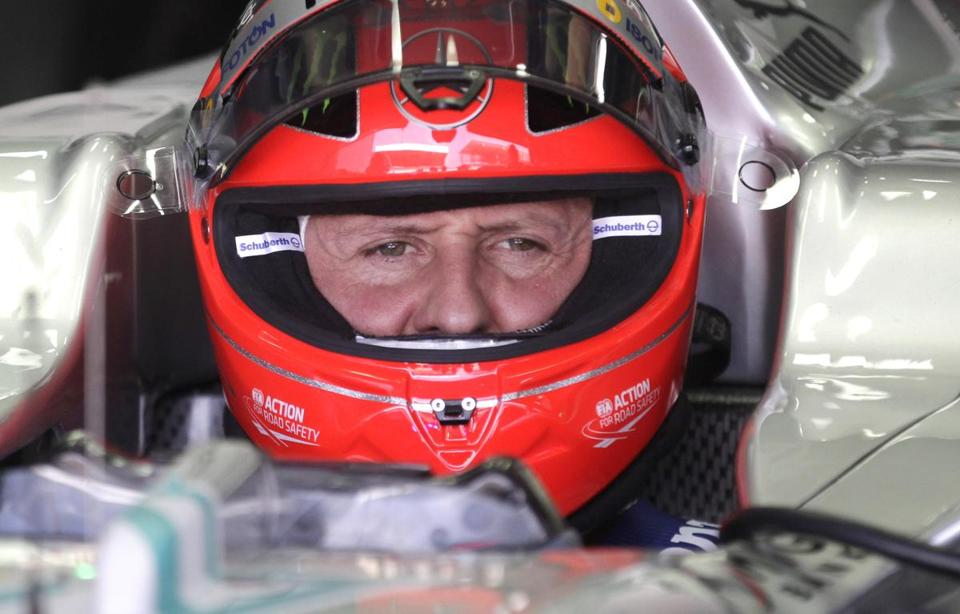Grand Prix driver Michael Schumacher sat in his car during a free practice at the Interlagos race track in Sao Paulo, Brazil.