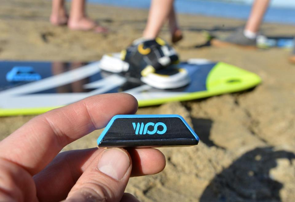 The Woo motion sensor, attached to a kiteboard, logs data such as height, air time, and G forces, and feeds it back to an app.