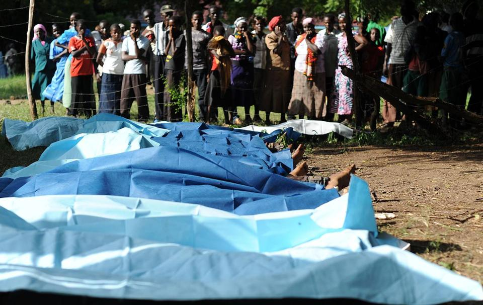Family members waited to collect bodies of their relatives on Monday at the hospital in Mpeketoni, Kenya. A total of 48 people were killed.