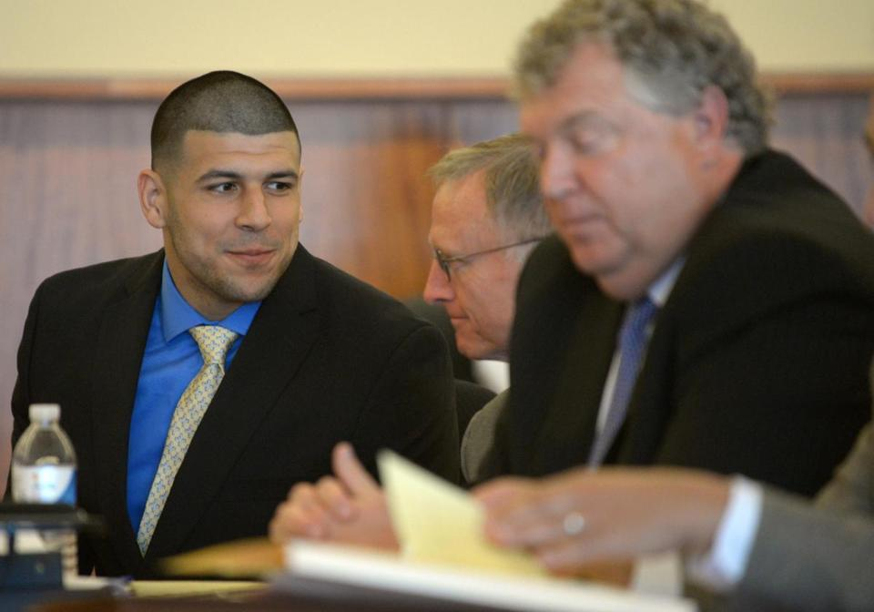 Aaron Hernandez (left) conferred with  defense attorney Charles Rankin during a hearing at the Bristol County Superior Court House in Fall River on Monday.
