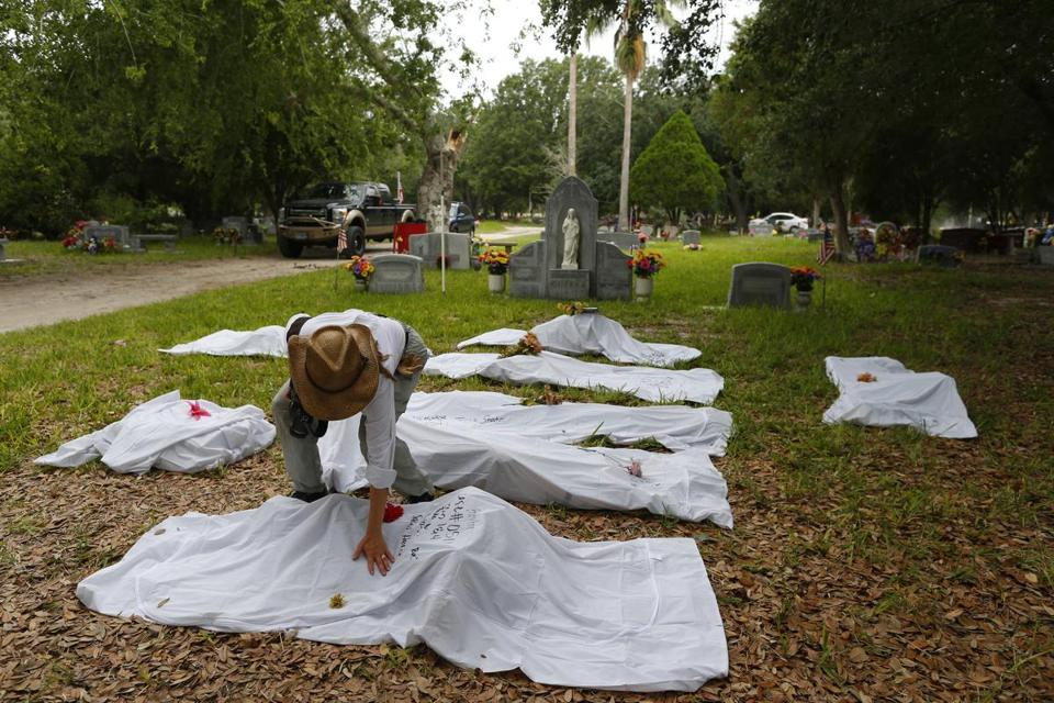 Professor Lori E. Baker placed her hand on one of the bodies taken from a paupers' grave.