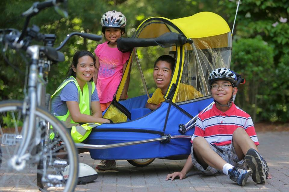 Concord teen Justin Moy (seated) and his mother and siblings are are gearing up for a 480-mile ride across Iowa with family friends.
