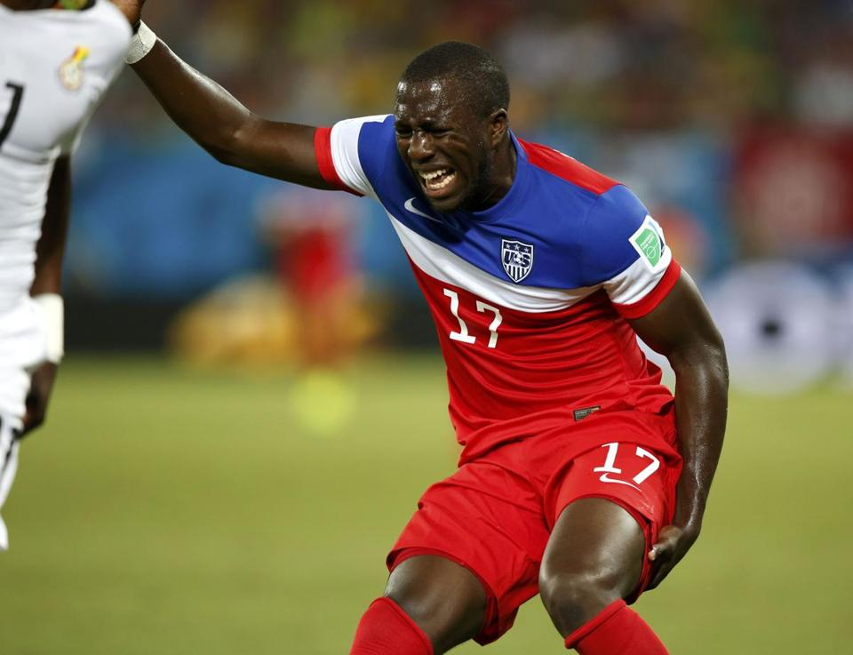 Jozy Altidore of the US grimaces as he grabs his left hamstring in the 21st minute. He left the game. REUTERS/Toru Hanai