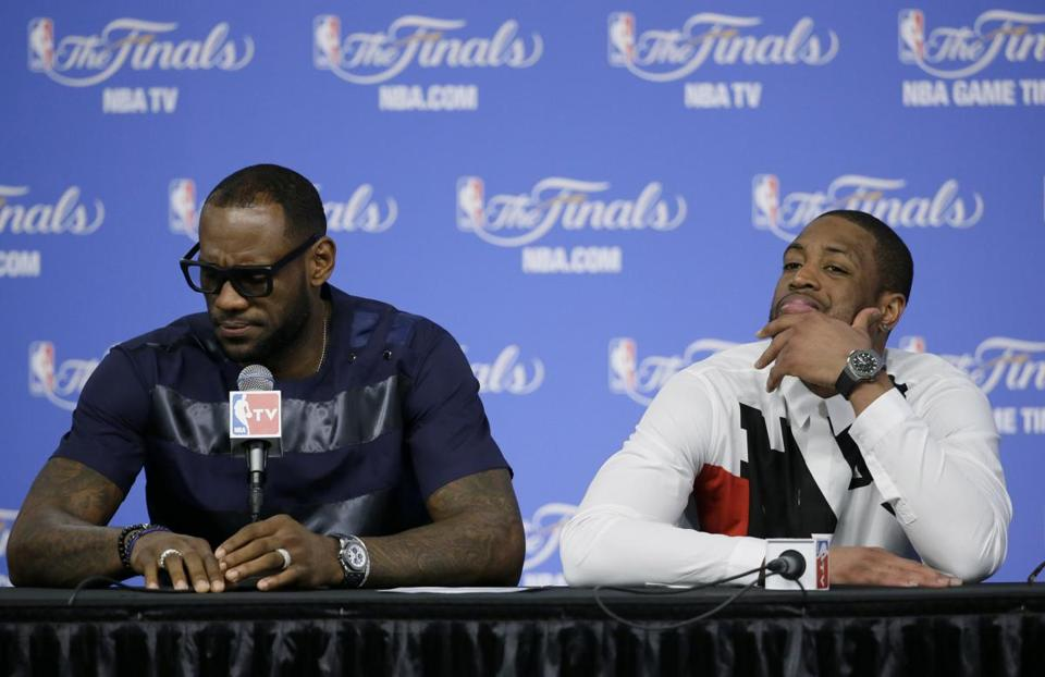Heat stars LeBron James (left) and Dwyane Wade sat next to each other to discuss Miami's series-ending loss to the Spurs in Game 5 Sunday, but they couldn't be farther apart. (AP Photo/Tony Gutierrez)