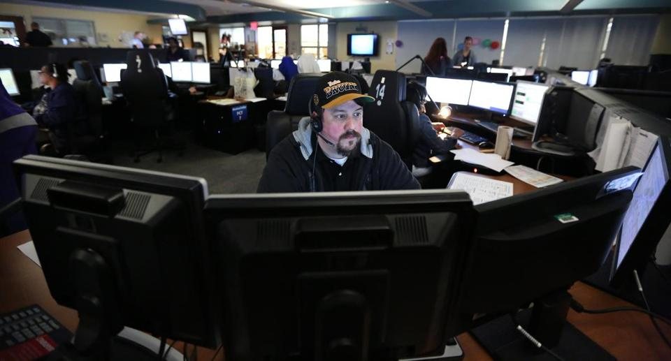 "Steven Campbell, a call taker for 19 years, took the first call of Boston's new 911 dispatch system at 10:12 a.m. Tuesday. The call: a car was parked at a fire hydrant. Campbell said the new system has ""been good; it's been easy. I like it."""