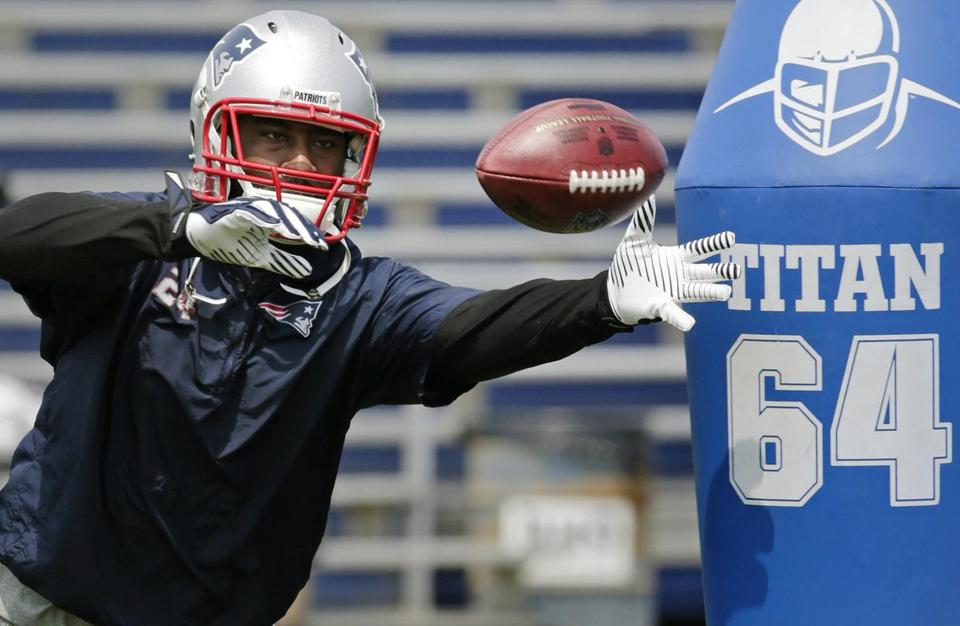 The Patriots hope Revis is deflecting many passes during the coming season.