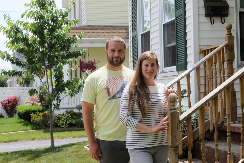 Jeff and Kate Sjoberg, outside their home at 11 Gilbert St. in Framingham, have played a role in the neighborhood's rebound.