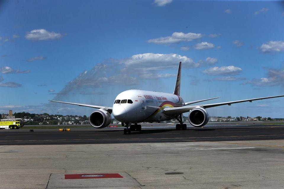 Hainan Airlines Flight 481 was greeted Friday after it touched down at Logan Airport.