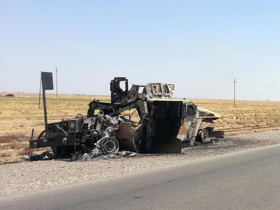 A burned Iraqi Army Humvee sat outside the Beiji oil refinery on Thursday.