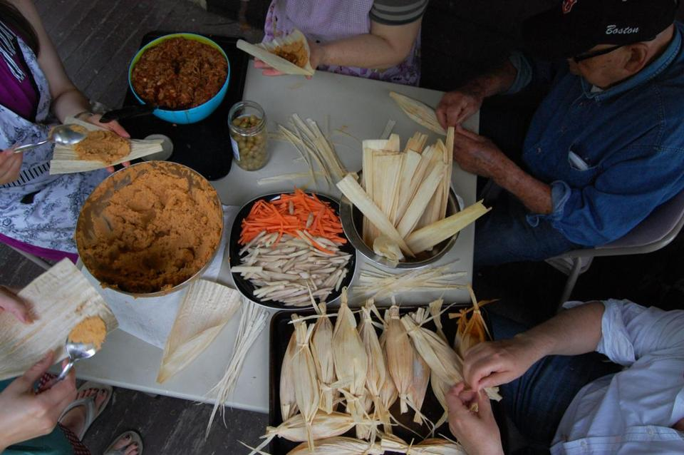 Delia Felix's tamales are filled and wrapped and — importantly — tied in assembly-line fashion in the author's kitchen.