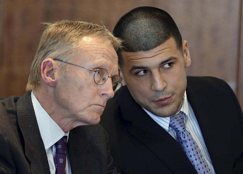 Former New England Patriots football player Aaron Hernandez, right, spoke to his attorney Charles Rankin during a hearing at Bristol Superior Court in Fall River in February.