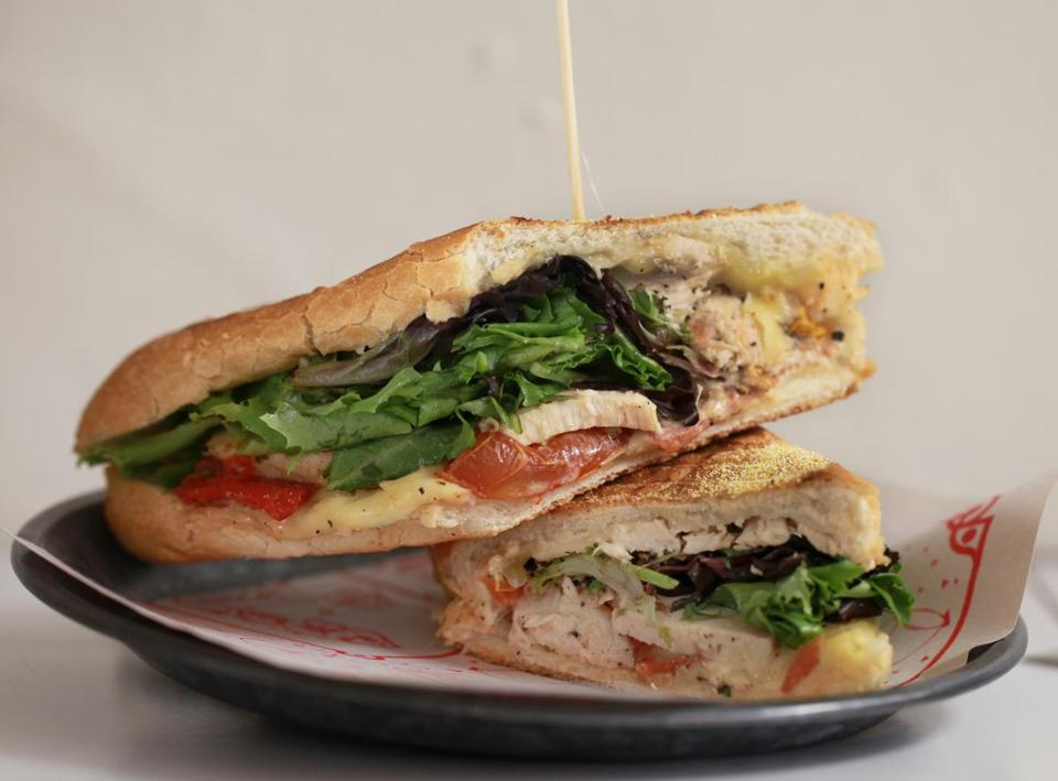 Boston, MA 062014 The Bird panini from Blunch in Boston's South End, Friday, June 20 2014. The sandwich is stuffed with artichoke aioli, mozzarella cheese, roasted tomatoes, chicken and baby greens. (Wendy Maeda/Globe Staff) section: Lifestyle slug: 02blunch reporter: Erin Ailworth