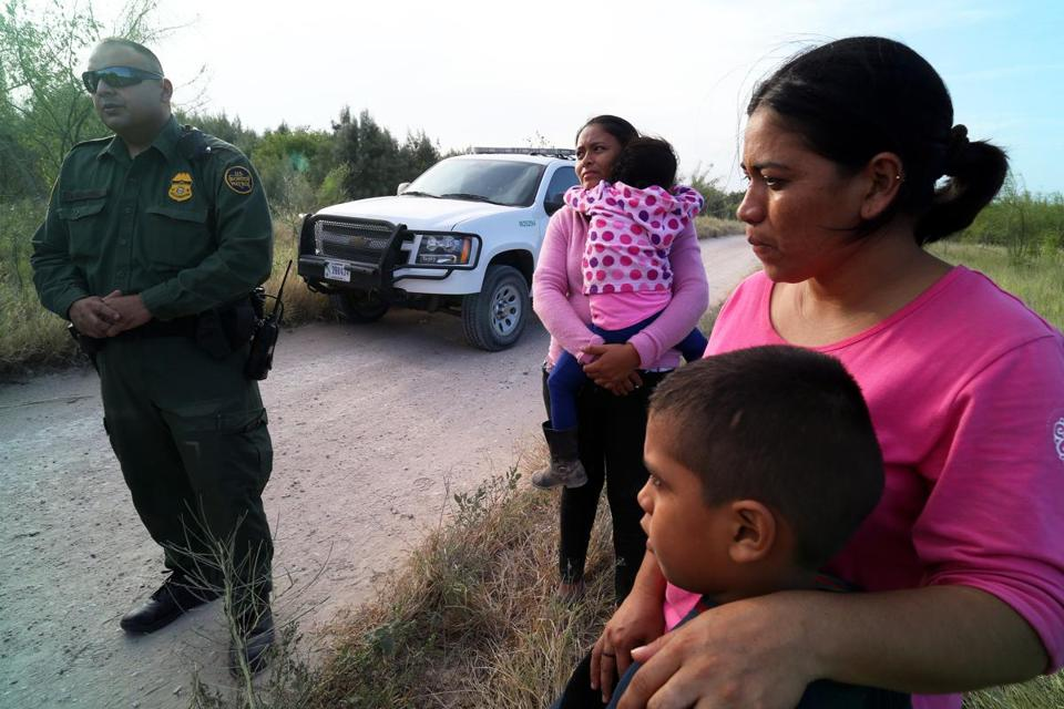Border Patrol agents processed a group of migrants from Honduras and Guatemala found walking near the Rio Grande near McAllen, Texas.