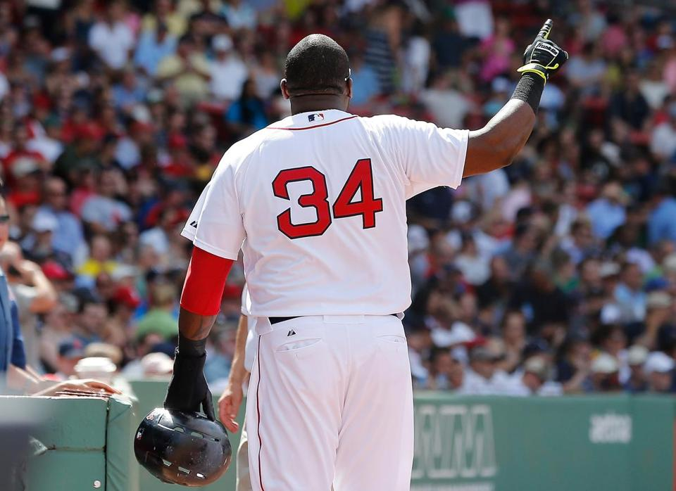 David Ortiz gestures to the press box in Wednesday's game, expressing displeasure with a scoring call.  Photo by Jim Rogash/Getty Images