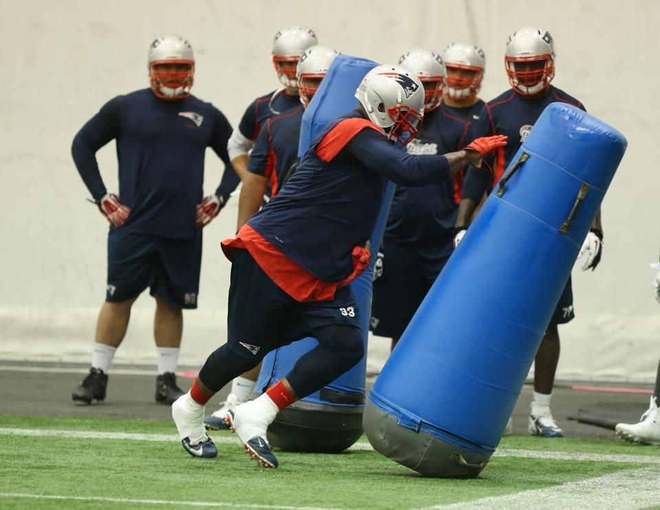 Tommy Kelly and the Patriots concluded their final minicamp workout on Thursday.