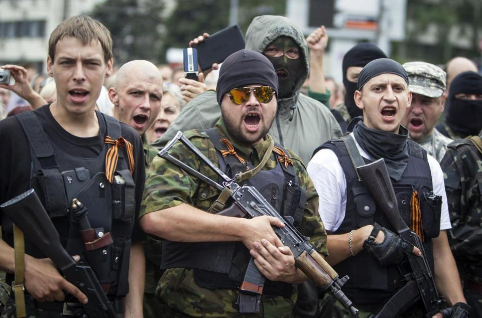 Armed pro-Russian separatists pledge an oath during ceremony Saturday in the eastern Ukraine city of Donetsk.