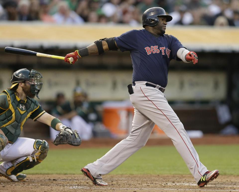 David Ortiz delivers an RBI single in the third inning Friday night in Oakland, Calif. (AP Photo/Ben Margot)