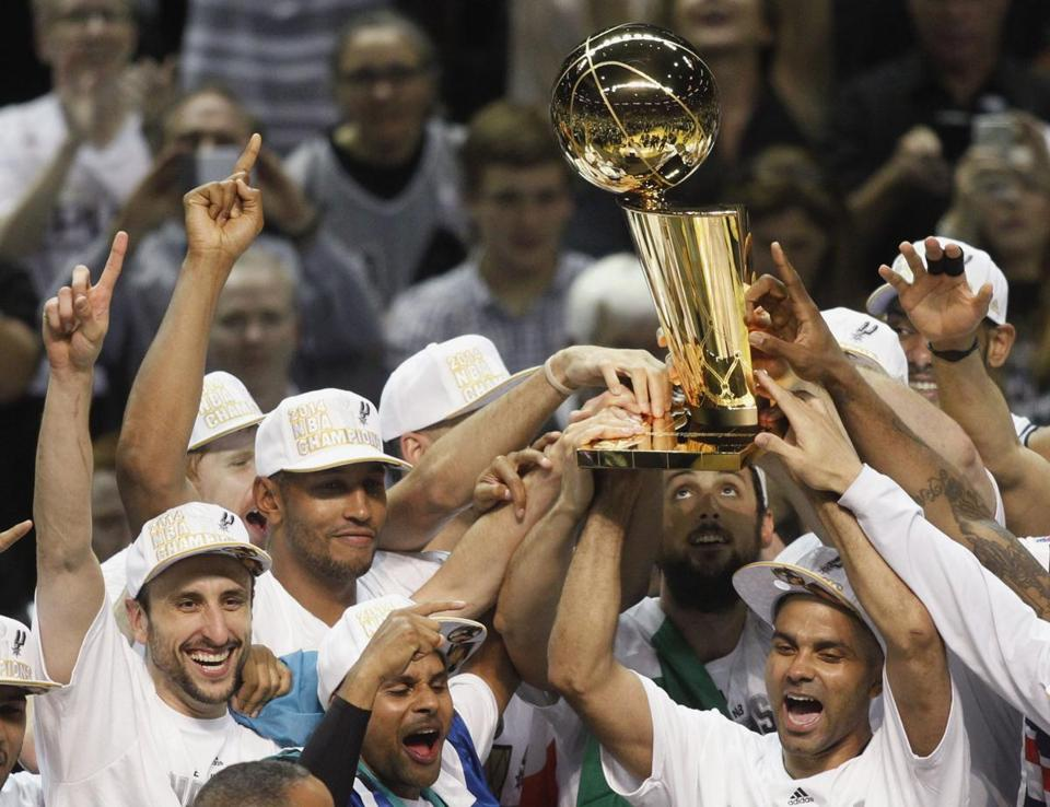 Spurs players hoisted the Larry O'Brien Trophy after capturing the team's fifth NBA championship.