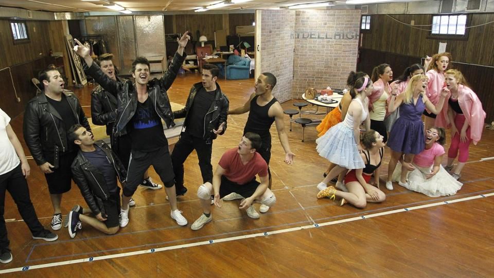 "The cast of the Theatre by the Sea production of ""Grease"" rehearses in front of a sparse set. The real set was created by designer Nate Bertone."