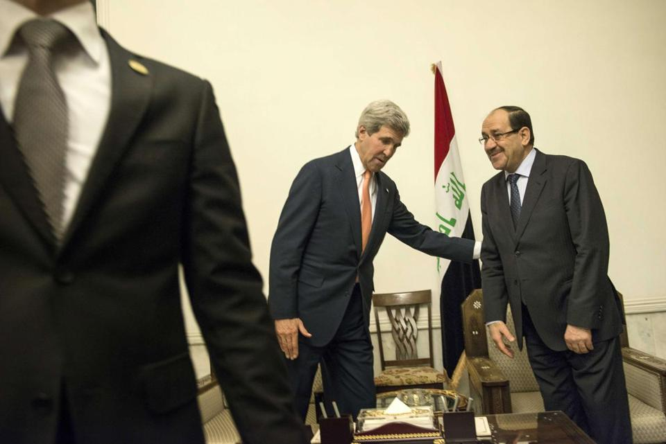 Iraqi Prime Minister Nouri al-Maliki (right) and Secretary of State John Kerry met at the Prime Minister's Office in Baghdad Monday morning.