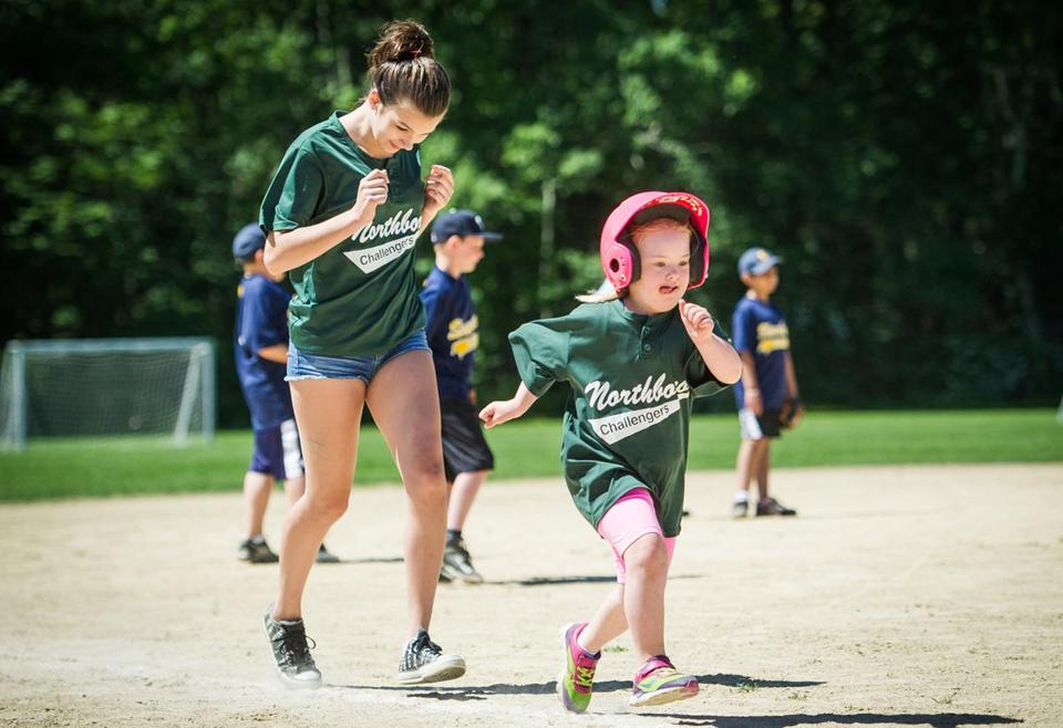 "With ""buddy'' Sophia Duellberg close behind, Olivia Cheney of Northborough races for home during a recent Challenger Baseball game."