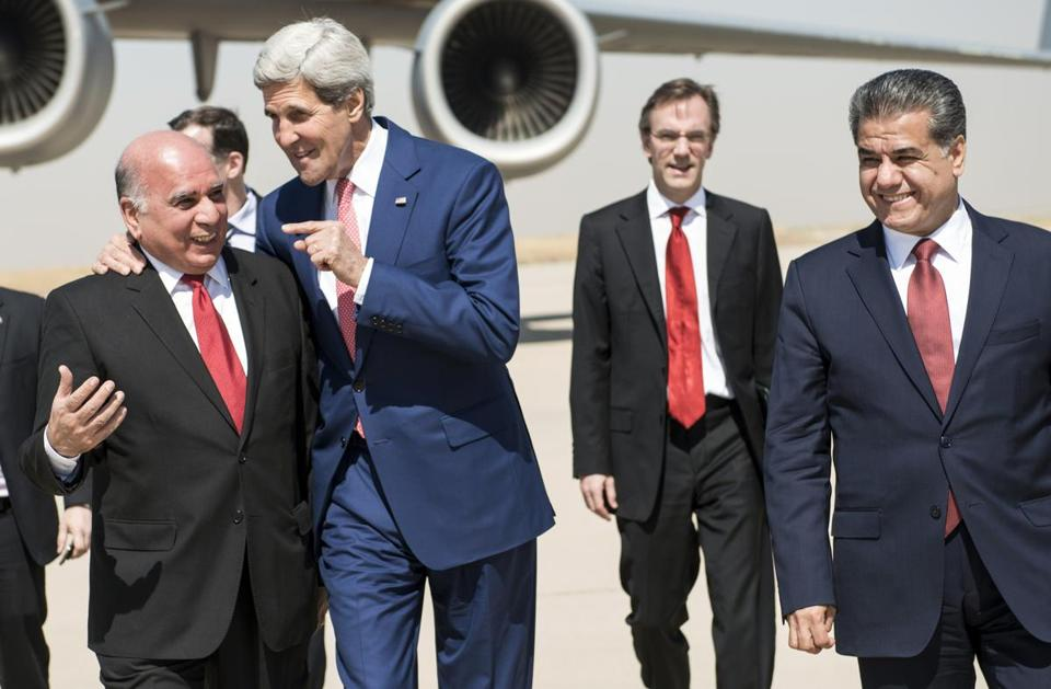 US Secretary of State John Kerry spoke with Fuad Hussein, left, chief of staff at the presidency of the Kurdistan regional government Tuesday. They are accompanied by Kurdish regional foreign relations minister Falah Mustafa Bakir, right, and other officials at Arbil International Airport.
