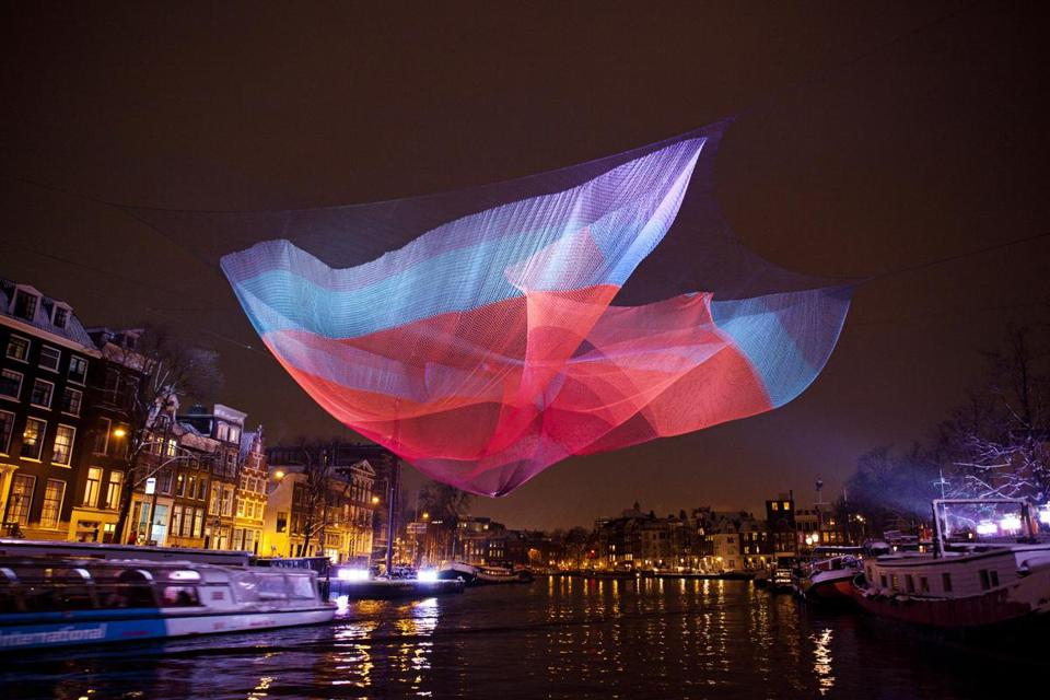 Janet Echelman's art was displayed in Amsterdam in 2012 to 2013. Her work will be installed in Boston next year.