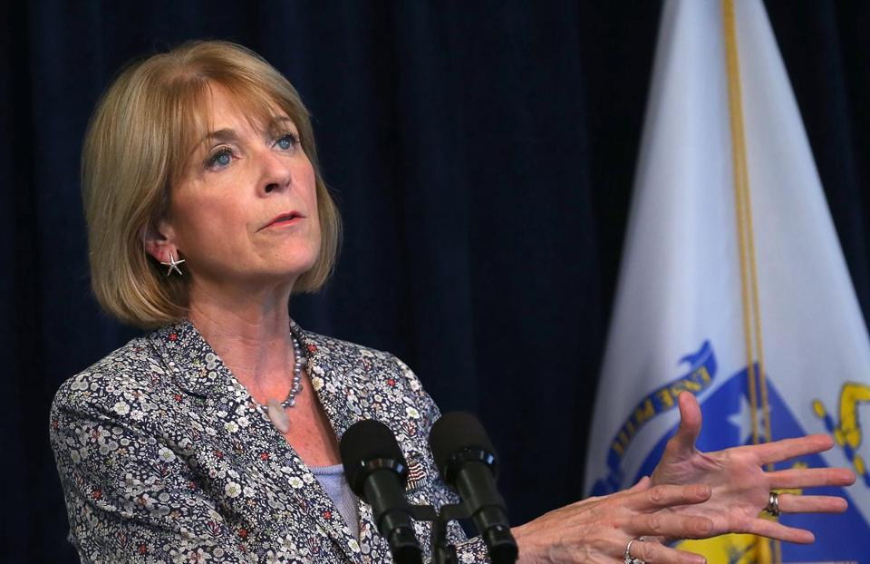 Martha Coakley criticized Charlie Baker over paid sick time.