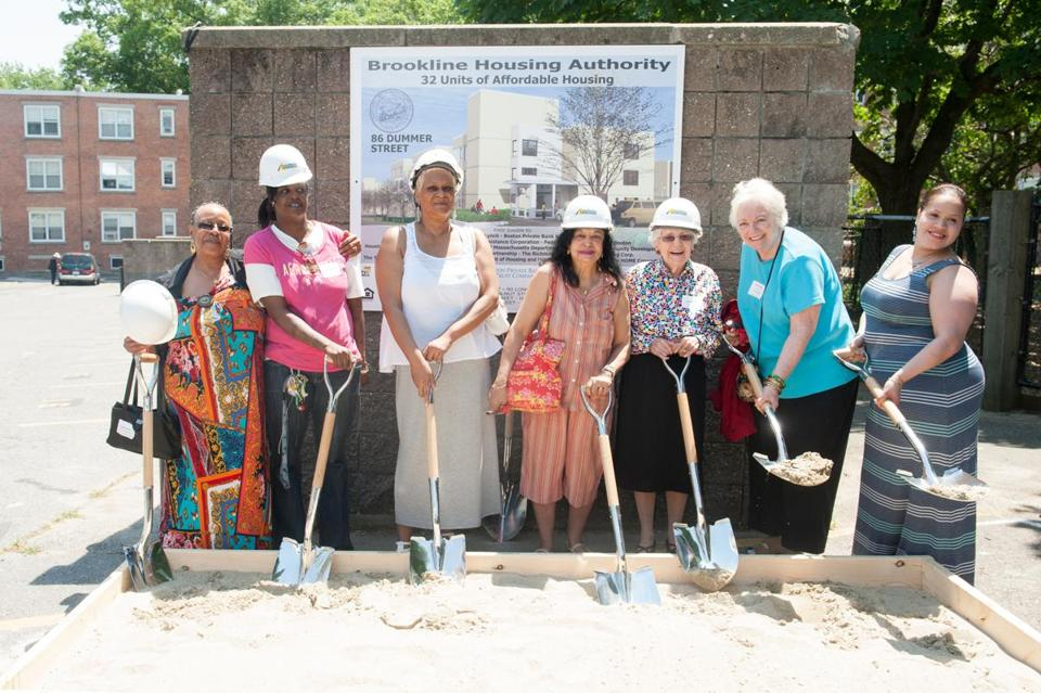 Brookline Housing Authority resident leaders (from left) Catherine Harris, Angela Sherrod, Sharon Drayton, Vera Sharma, Agnes Rogers, Rita McNally, and Jaymmy Colon take part in Tuesday's ceremony.
