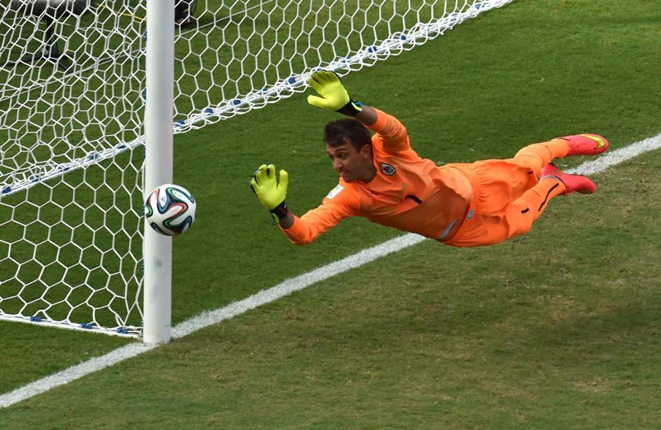 Uruguay goalkeeper Fernando Muslera dives for a ball during his team's win over Italy YASUYOSHI CHIBA/AFP/Getty Images