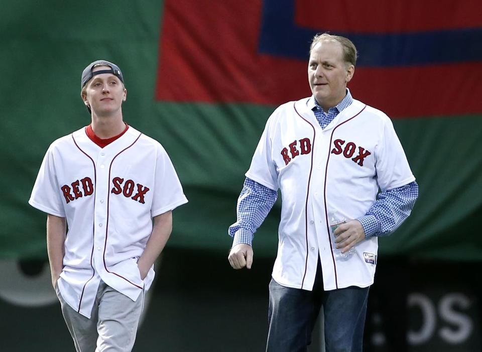 Former Boston Red Sox pitcher Curt Schilling walked with his son, Garrett, onto the infield at Fenway Park.