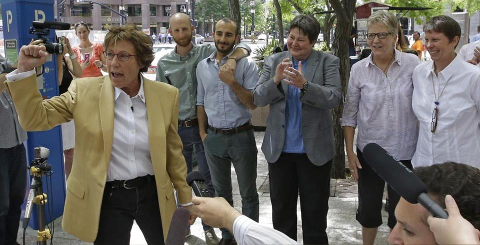 Peggy Tomsic (left), the attorney for five of the six people who challenged Utah's gay marriage ban, hailed the decision by the US Court of Appeals for the 10th Circuit. Tomsic held a news conference in Salt Lake City with the plantiffs.