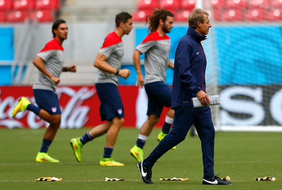 Coach Jurgen Klinsmann (right) and his players are in lockstep regarding Thursday's game: They want to win, period. Photo by Kevin C. Cox/Getty Images