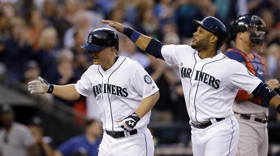 Seattle's Kyle Seager, left, is congratulated by Robinson Cano after Seager's three-run homer broke open a close game.