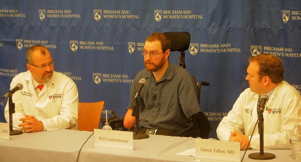 Will Lautzenheiser (right), a quadruple amputee and a former BU professor, spoke at a press conference at Brigham and Women's Hospital.