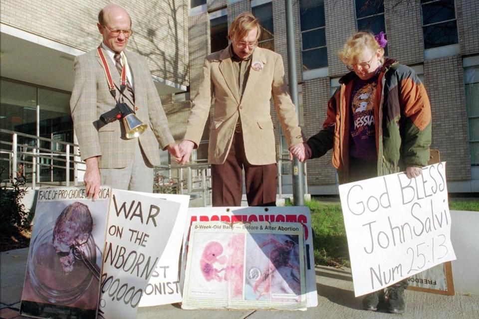 Abortion protesters (from left) Ed Hyatt, Bill Powell and his wife, Rae Powell, all of Virginia Beach, Va., prayed for John C. Salvi 3d in front of the Norfolk City Jail.