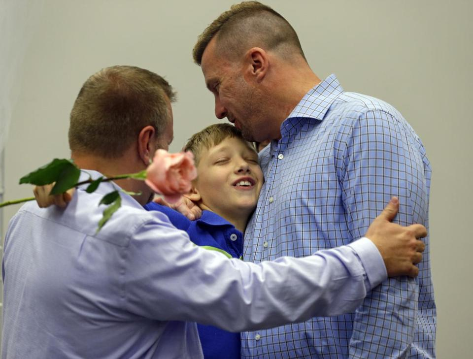 Michael Foster (left) and Larry Foster (right) wed in Indiana, where a US judge struck down a ban on same-sex marriage.