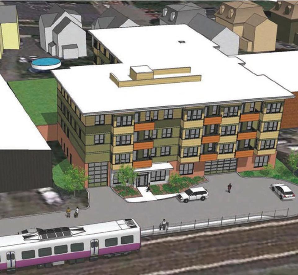 The 27-unit apartment building, seen in this artist's rendering, would be right next to the Fairmount commuter rail station.