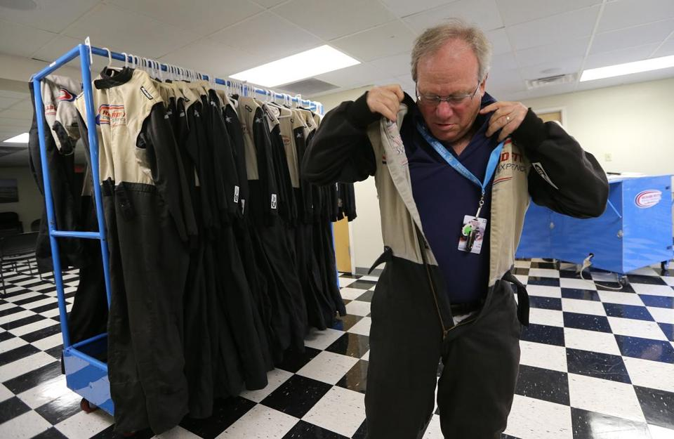 Loudon, NH - 06/27/14 - Globe reporter Joe Kahn puts on his driving suit at the Richard Petty Driving Experience at New Hampshire Motor Speedway, Loudon, NH. - (Barry Chin/Globe Staff, Section: Living/G, Reporter: Joe Kahn, Topic: NASCAR, LOID: 7.3.3940325283.