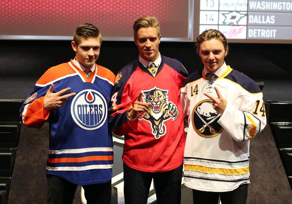 Top overall pick Aaron Ekblad (center) is flanked by No. 2 pick Sam Reinhart (right) and No. 3 pick Leon Draisaitl. Bill Streicher/USA Today.