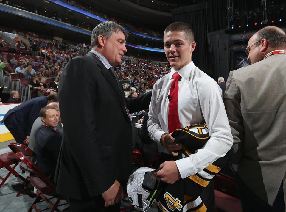 Second-round pick Ryan Donato meets some of the Bruins' management team, including team president Cam Neely (left), after being selected.