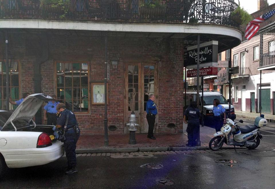 New Orleans authorities worked at the scene of a shooting on Bourbon Street that left nine people wounded, two critically.