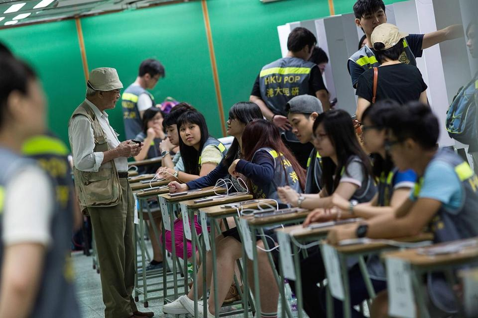 People voted Sunday during an unofficial referendum on democratic reform in Hong Kong.